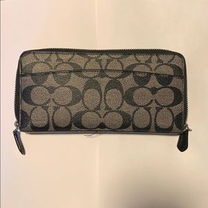 Gently used Coach Wallet.